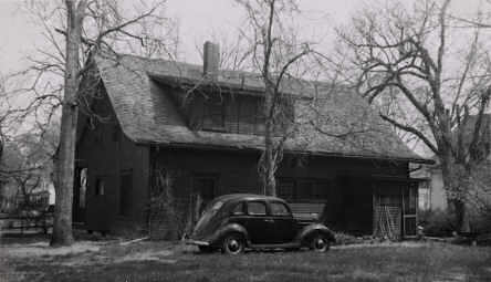 Rudolph Umland's 1958 snapshot of May and Lowry Wimberly's house and car