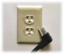 [photo: plug loose from outlet]