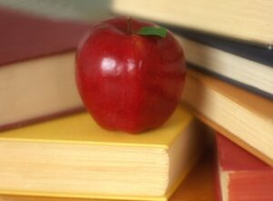 photo of apple with books