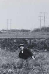 photo: Rudolph Umland resting beside the tracks near Philadelphia, Pennsylvania, 1929