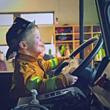 photo of child in a fire truck